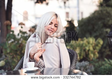Stylish Woman 20-24 Year Old With Long Hair Wearing Pink Winter Coat Leaning On Tree In Park Close U