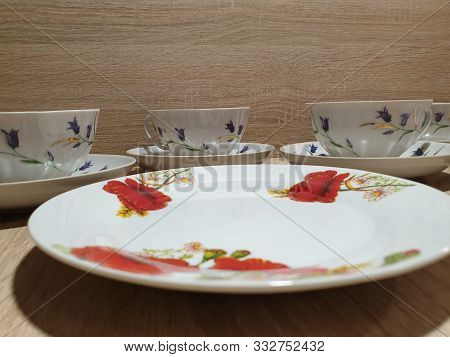 Tea-set. Porcelain Tableware Set. Plates And Cups.