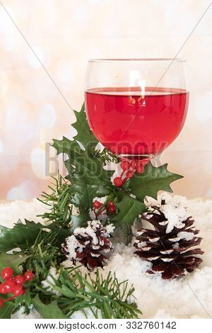 Port Wine Glass With Pine Cone And Mistletoe On Festive Background. Holiday And Christmas Theme