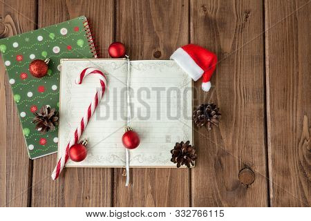Christmas Or New Year Planning Background On A Wooden Background. Prepare To Winter Holidays. Top Vi