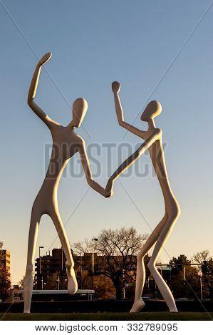 Denver, Colorado - November 9, 2019: The Dancers Public Sculpture In Denver, Colorado. The Dancers W
