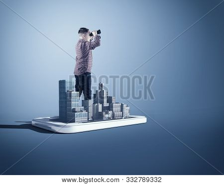 Man Looking Through Binoculars In A City On A Smartphone.