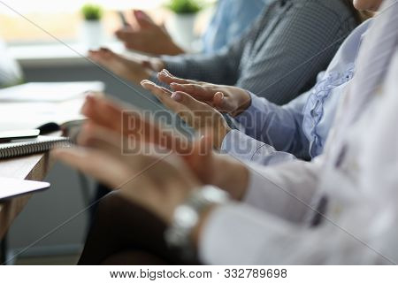 Close-up Of Business People Hands. Man And Woman Sitting In Office Conference Room And Applauding On