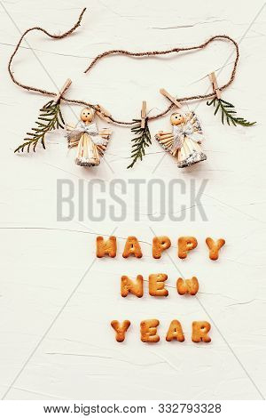 The Words Happy New Year Are Made Of Cookie Letters. Flat Lay Composition With Green Plant Brench, A