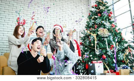 Asian People Party Celebrate Christmas And New Year Eve In House And Christmas Tree Decorate With Co