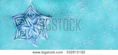 Snowflake From Paper With Colorful Confetti On Trendy Mint Colored Background. Simple Holiday Concep