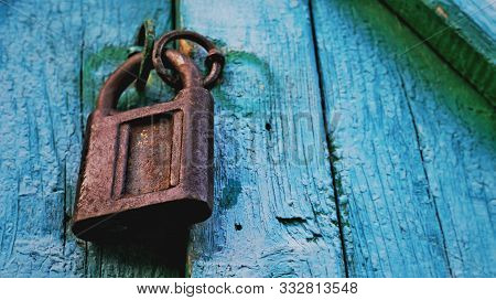Old Lock Vintage Door Colorful Photo Close Up. Old Wooden Door Gate Closed With Metal Chain & Rusty