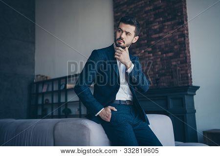 Photo Of Handsome Business Person Guy Sitting Minded On Big Sofa In Trendy Modern Trendy Design Apar