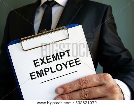 Exempt Employee Sign Is In The Hands.