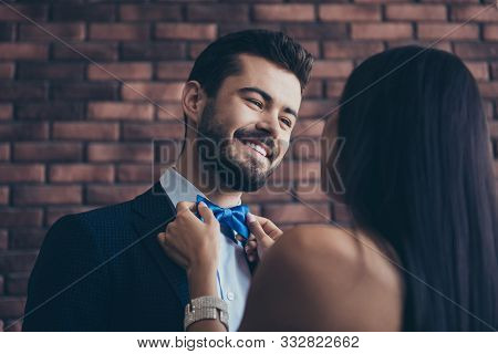 Closeup Photo Of Two Affectionate People Couple Guy Looking Eyes Lady Who Fixing Blue Stylish Bow Ti