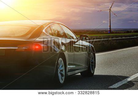 car on autobahn at sunset