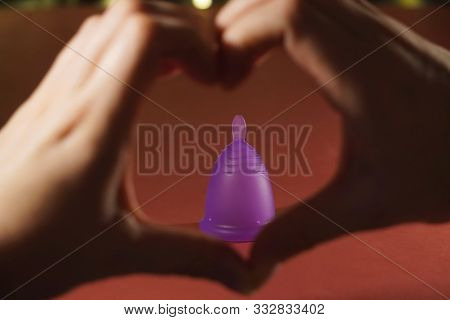 Hands In The Shape Of A Heart And A Menstrual Cup. Zero Weist, The Trend For Environmental Friendlin
