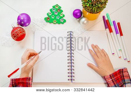 Dear Santa Letter, Christmas Card. The Child Holds A Pen In His Left Hand, A Lefty, Writes On A Whit
