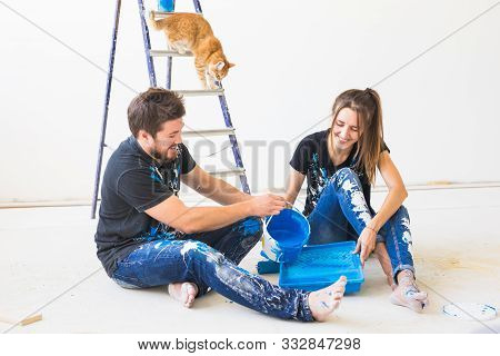 Repair, Pet, Family And Renovation Concept - Young Couple With Cat Is Going To Painting The Walls, C