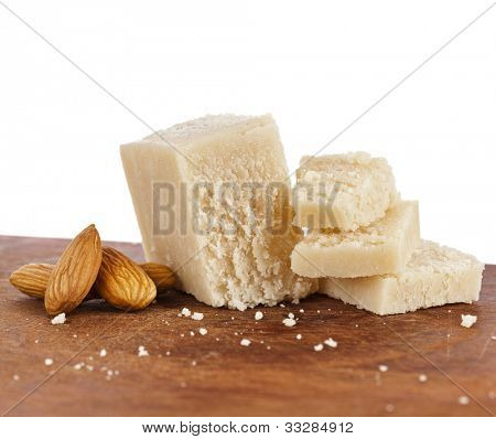 marzipan  with almonds on wooden board poster