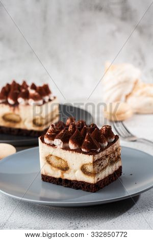 Tiramisu - Classical Dessert With Mascarpone And Coffee. Delicious Tiramisu Cake On A Darck Plate On