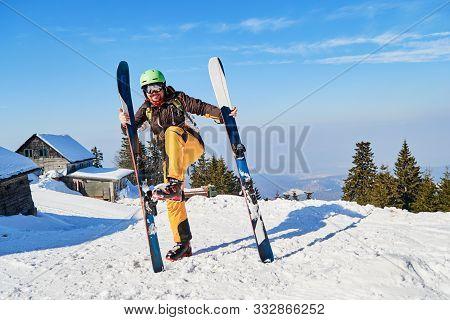 Funny Skier Mimics Putting His Skis On Wrong, Vertically. Location: Poiana Brasov Ski Resort, Romani