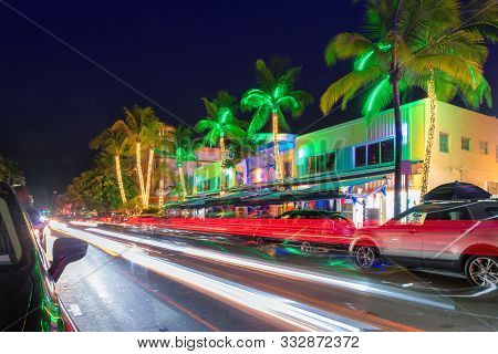 Night View Of Ocean Drive In Miami Beach, Florida - Hotels And Restaurants At Sunset On Ocean Drive,