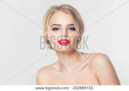 Attractive Female Model Face On White Background. Red Lips, Blonde Updo Hairdo