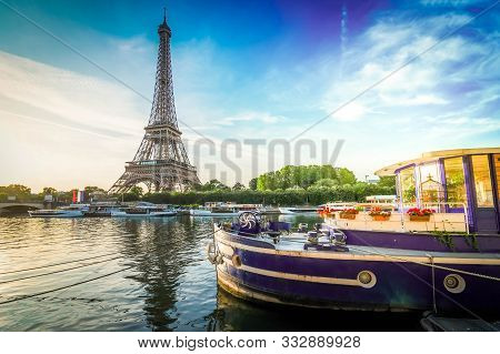 Paris Eiffel Tower Reflecting In River Seine At Sunrise With Moored Boats In Paris, France. Eiffel T