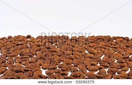 Spilled Coffee Beans On A Light Background.