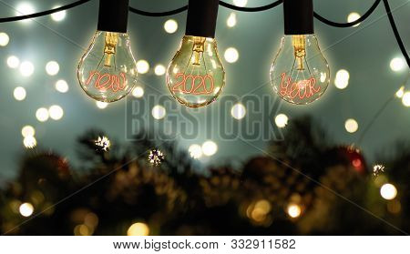 The Concept Of The New 2020 Year. Filament Lamps With New 2020 Year. Cozy Image. Hygge Mood.