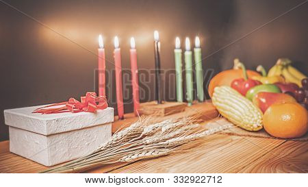 Kwanzaa Holiday Concept With Decorate Seven Candles Red, Black And Green, Gift Box, Pumpkin,corn And