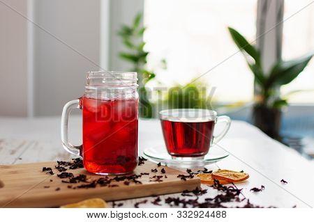Cup Of Hibiscus Tea (karkade, Red Sorrel, Agua De Flor De Jamaica) On A Table.