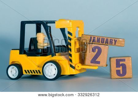 January 25th. Day 25 Of Month, Construction Or Warehouse Calendar. Yellow Toy Forklift Load Wood Cub