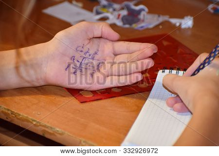 Cheat Sheet On The Hand. Formula Written In The Palm Of A Schoolboy. Hint In The Palm Of Your Hand..
