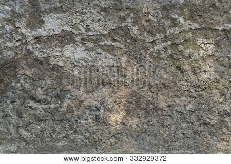 Texture Of Natural Gray Weathered Stone. Background Of Stone Covering A Wall Or Floor Texture Surfac