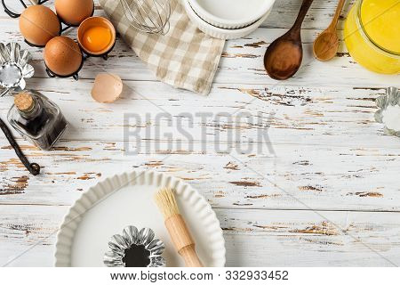 Baking Pastry Background Frame, Ingredients, Kitchen Utensils On Rustic Wooden Background