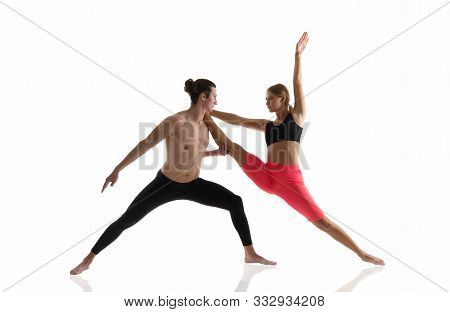Overall Fitness. Couple Of Athletes Isolated On White. Athletic Man And Woman Perform Pilates Workou