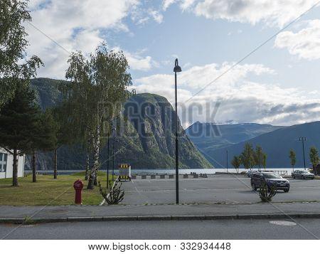 Valldal, Norway, September 7, 2019: View Of Shore Norddalsfjorden Fjord In Village Valldal, Administ