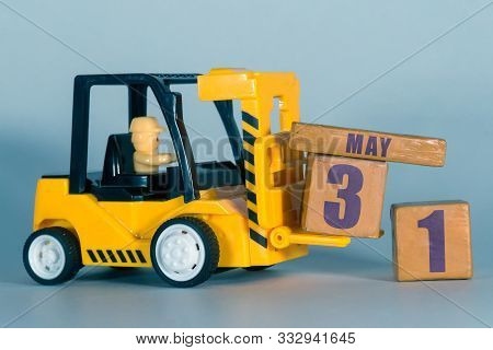 May 31st. Day 31of Month, Construction Or Warehouse Calendar. Yellow Toy Forklift Load Wood Cubes Wi