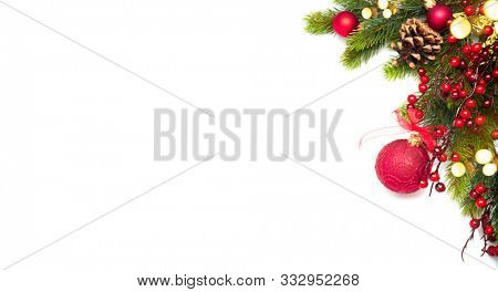 Red Christmas and New Year border Decoration, isolated on white background. Border art design with holiday baubles. Beautiful Xmas tree closeup decorated with balls, garland, tinsel. Top view, flatlay
