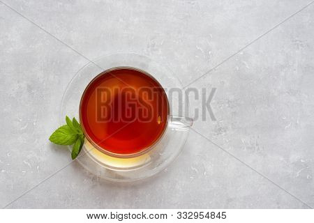 Top View Of Glass Cup With Tea On Light Background