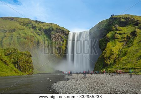 Iceland waterfall Skogafoss in Icelandic nature landscape. Long exposure of Famous tourist attraction and landmarks destination in Icelandic nature landscape on South Iceland.