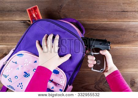 Girl Hides A Gun In A School Backpack. Covert Carrying Weapons For Protection. Weapons At School, As