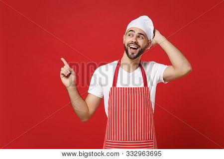 Funny Chef Cook Baker Man In Striped Apron White T-shirt Toque Chefs Hat Posing Isolated On Red Back