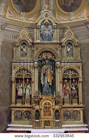 IVANIC GRAD, CROATIA - SEPTEMBER 25, 2011: Main altar of the Visitation of Mary in the church of the Saint Peter in Ivanic Grad, Croatia