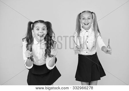 Back To School On September 1. Happy Small Children Holding Markers And Scissors On September 1. Lit