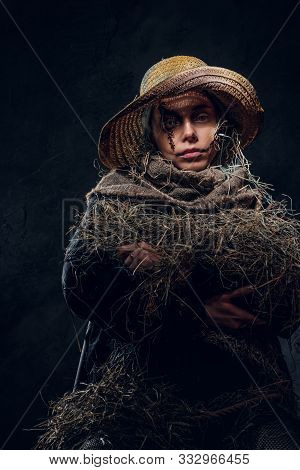 Young Artistic Woman Is Posing For Photographer In A Role Of Creepy Scarecrow.