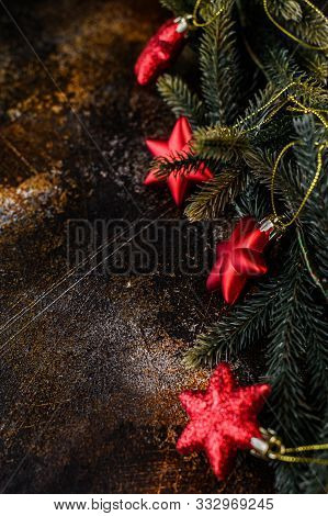 Happy New Year 2020. Christmas Background With Xmas Tree, Red Stars And Glowing Golden Bokeh Lights