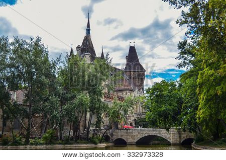 Historical Building In Budapest - Vajdahunyad Castle With Lake Over The Overcast Sky In Main City Pa