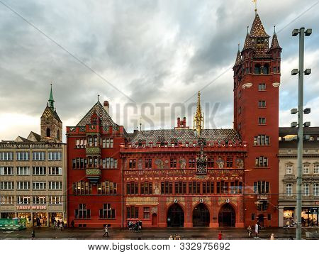 Basel, Switzerland - November 03, 2019: Famous Red Painted Town Hall Or Rathaus Building Facade In B