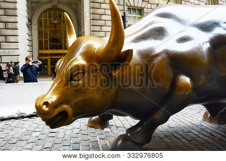 New York, NY - 05 NOV 2019: Charging Bull, or the Wall Street Bull or the Bowling Green Bull stands in Bowling Green in the Financial District in Manhattan created by Sicilian artist Arturo Di Modica.