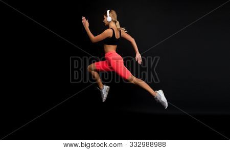 Run Hard To Get Into Shape. Woman Run Black Background. Jogger Jump With Long Run. Fit Athlete In Fa