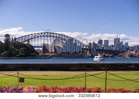 Sydney Opera House And Harbour Bridge With Jacaranda Tree And Buildings In Background, Sydney Opera