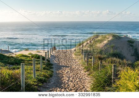 Entrance Path To Ocean Beach With Sand With Many Footsteps. Summer Beach Holiday Background